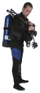 Diver putting on gear over wetsuit
