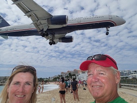 Planes flying over beach on St. Martin