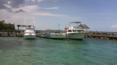 Sandals main scuba diving boat on right