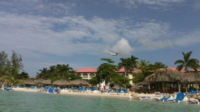 Airplane flying over Sandals Montego Bay, Jamaica