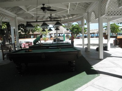 Sandals Montego Bay pool tables; beach bar in background