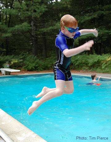 Children's wetsuits - having fun in the pool.