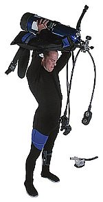 Diver putting on scuba gear.